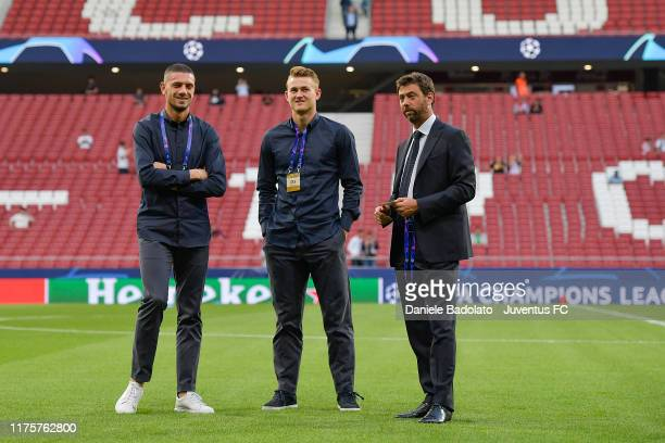 Juventus players Merih Demiral and Matthijs de Ligt with Andrea Agnelli during the UEFA Champions League group D match between Atletico Madrid and...