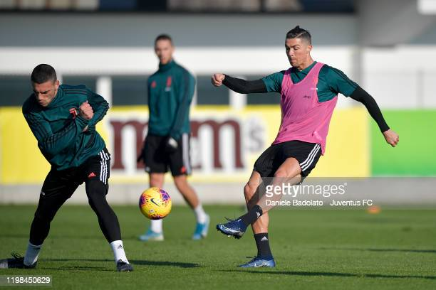 Juventus players Merih Demiral competes for the ball with Cristiano Ronaldo during a training session at JTC on January 09, 2020 in Turin, Italy.