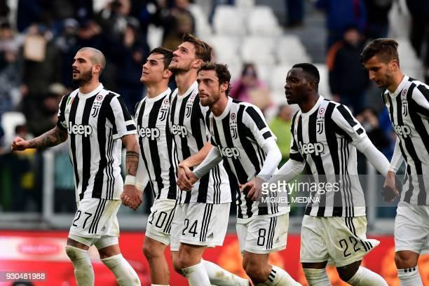 Juventus' players midfielder Stefano Sturaro forward from Argentina Paulo Dybala defender Daniele Rugani midfielder Claudio Marchisio and midfielder...