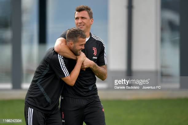 Juventus players Miralem Pjanic and Mario Mandzukic during a training session at JTC on August 05 2019 in Turin Italy