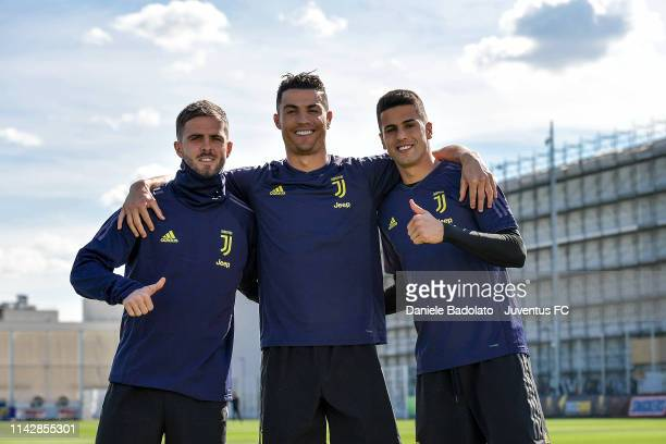 Juventus players Miralem Pjanic Cristiano Ronaldo and Joao Cancelo during the Champions League training session at JTC on April 15 2019 in Turin Italy