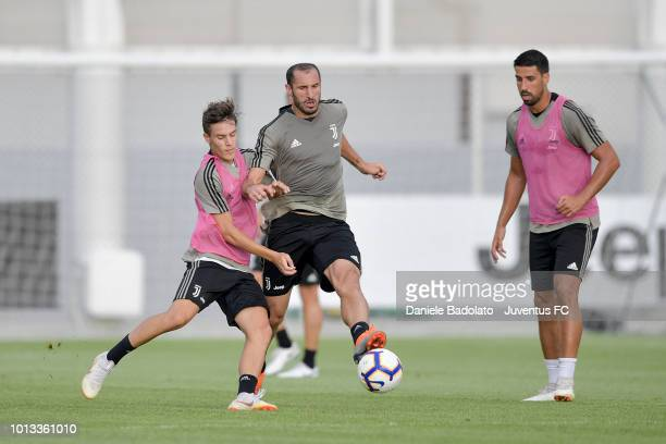 Juventus players Nicolo Fagioli and Giorgio Chiellini during a Juventus training session at JTC on August 8 2018 in Turin Italy