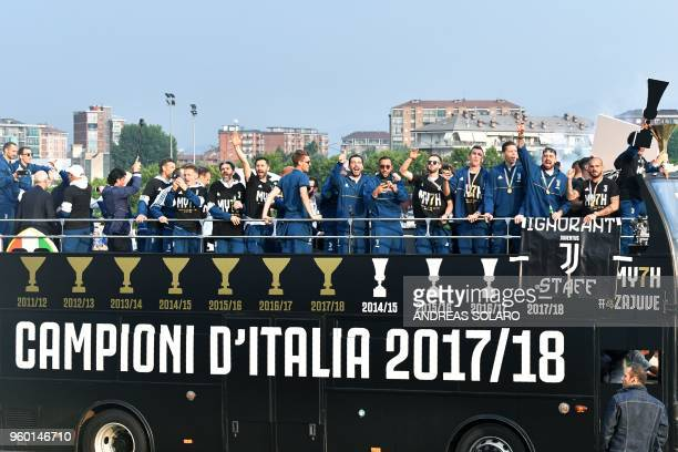 Juventus' players parade aboard an opentop bus to celebrate the scudetto with supporters in Turin after the Italian Serie A last football match of...