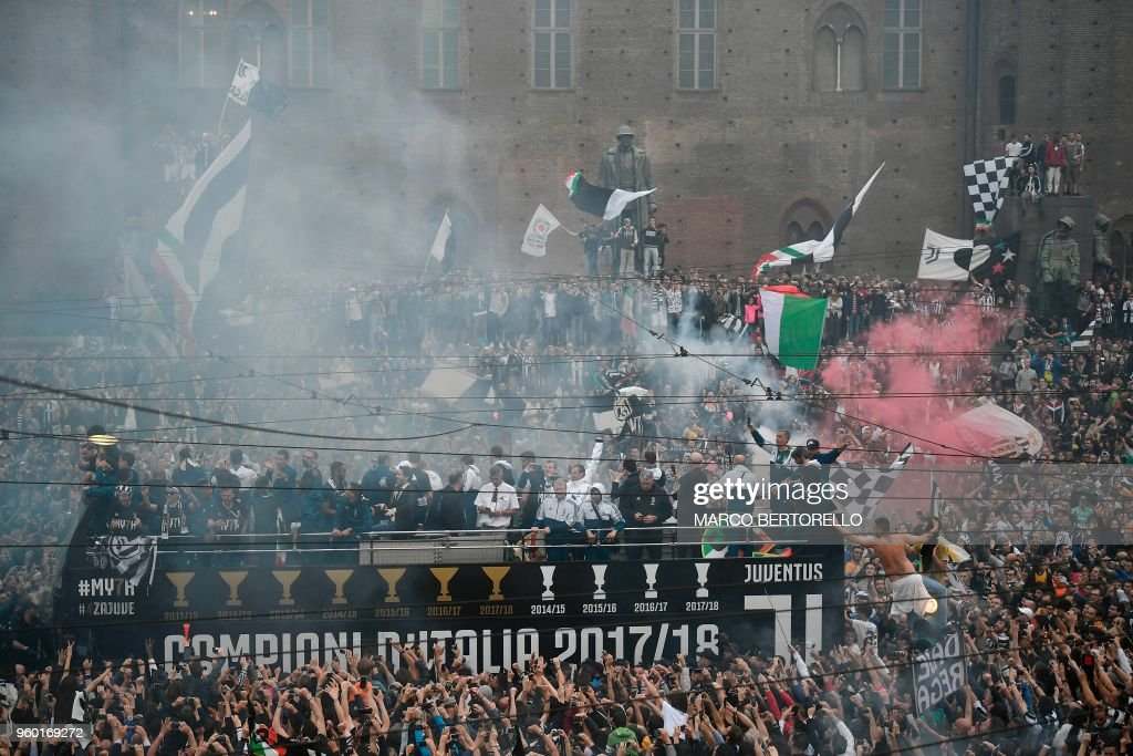 Juventus' players parade aboard an open-top bus to celebrate the 'scudetto' with supporters in central Turin after the Italian Serie A last football match of the season, on May 19, 2018. Juventus won their 34th Serie A title and seventh in succession.