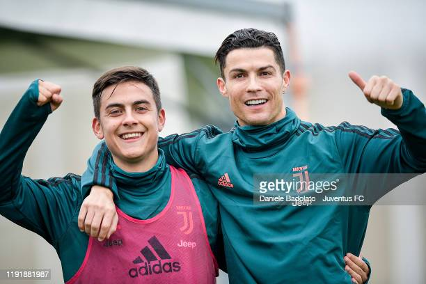 Juventus players Paulo Dybala and Cristiano Ronaldo during a training session at JTC on December 04 2019 in Turin Italy