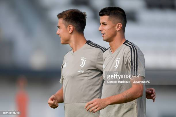 Juventus players Sami Khedira and Mario Mandzukic joking with Blaise Matuidi during a Juventus training session at JTC on August 20 2018 in Turin...