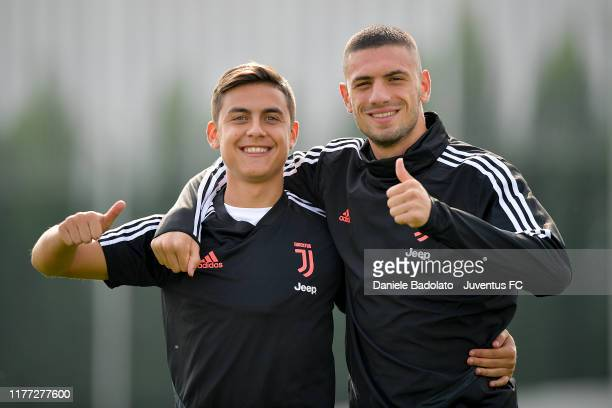 Juventus players Paulo Dybala and Merih Demiral during a training session at JTC on September 26 2019 in Turin Italy
