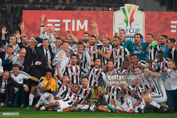 TOPSHOT Juventus players pose with the trophy after winning the Italian Tim Cup final Juventus vs AC Milan at the Olympic stadium on May 9 2018 in...