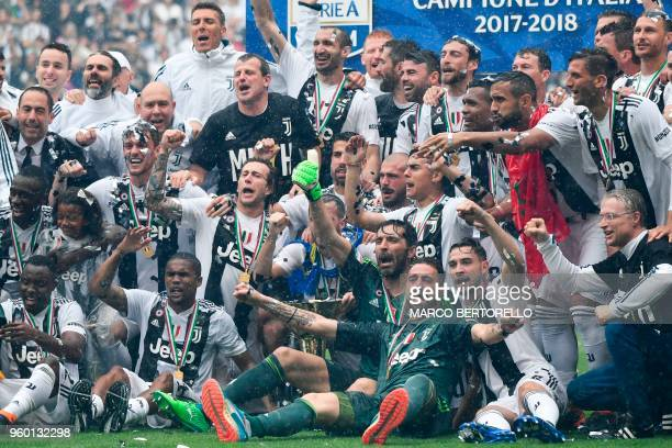 Juventus' players pose with the trophy during the victory ceremony following the Italian Serie A last football match of the season Juventus versus...