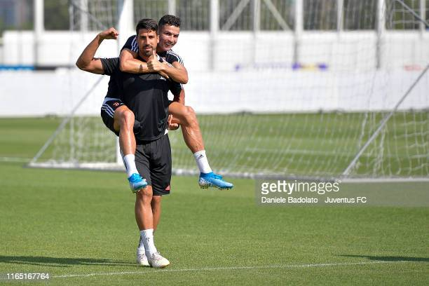 Juventus players Sami Khedira and Cristiano Ronaldo during a training session at JTC on July 23, 2019 in Turin, Italy.