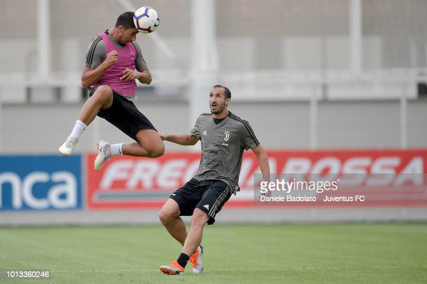 Juventus players Sami Khedira and Giorgio Chiellini during a Juventus training session at JTC on August 8 2018 in Turin Italy