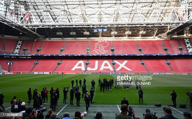 Juventus' players take part in a walk around the pitch at the Johan Cruyff ArenA in Amsterdam on April 9 on the eve of the UEFA Champions League...