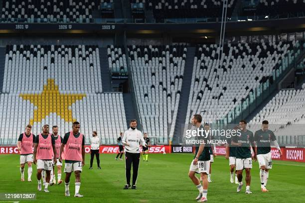 Juventus players warm up in an empty stadium prior to the Italian Cup semi-final second leg football match Juventus vs AC Milan on June 12, 2020 at...