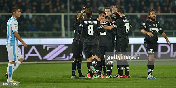 Juventus playes celebrate Juventus' forward Fabio Quagliarella's goal during the Italian Serie A football match between Pescara and Juventus on...