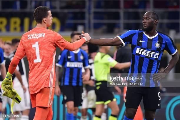 Juventus' Polish goalkeeper Wojciech Szczesny and Inter Milan's Belgian forward Romelu Lukaku tap hands at the end of the Italian Serie A football...