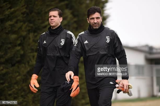 Juventus' Polish goalkeeper Wojciech Szczesny and Juventus' goalkeeper Gianluigi Buffon attend a training session on the eve of the UEFA Champions...