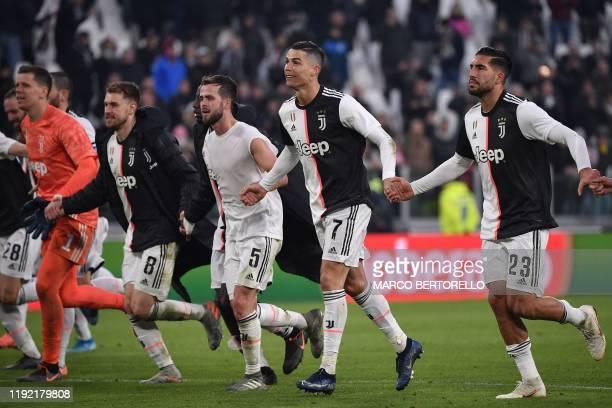 Juventus' Polish goalkeeper Wojciech Szczesny Juventus' Welsh midfielder Aaron Ramsey Juventus' Bosnian midfielder Miralem Pjanic Juventus'...