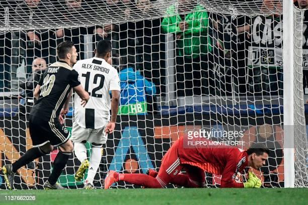 Juventus' Polish goalkeeper Wojciech Szczesny makes a save during the UEFA Champions League quarter-final second leg football match Juventus vs Ajax...