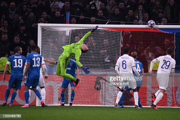 Juventus' Polish goalkeeper Wojciech Szczesny makes a save during the UEFA Champions League round of 16 first-leg football match between Lyon and...