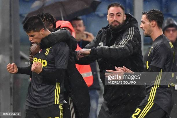 Juventus' Portuguese defender Joao Cancelo and Juventus' Italian defender Mattia De Sciglio celebrate after Cancelo scored an equalizer during the...