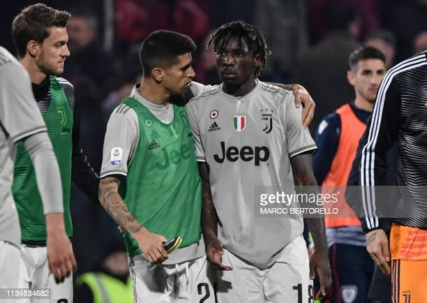 Juventus' Portuguese defender Joao Cancelo comforts Juventus' Italian forward Moise Kean at the end of the Italian Serie A football march Cagliari vs...