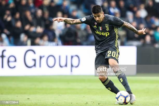 Juventus' Portuguese defender Joao Cancelo shoots before Juventus' Italian forward Moise Kean bounces the ball into the goal to open the scoring...