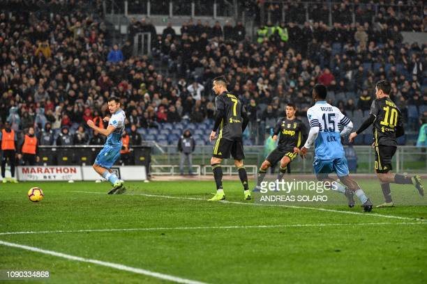 Juventus' Portuguese defender Joao Cancelo shoots to score an equalizer as Juventus' Portuguese forward Cristiano Ronaldo looks on during the italian...