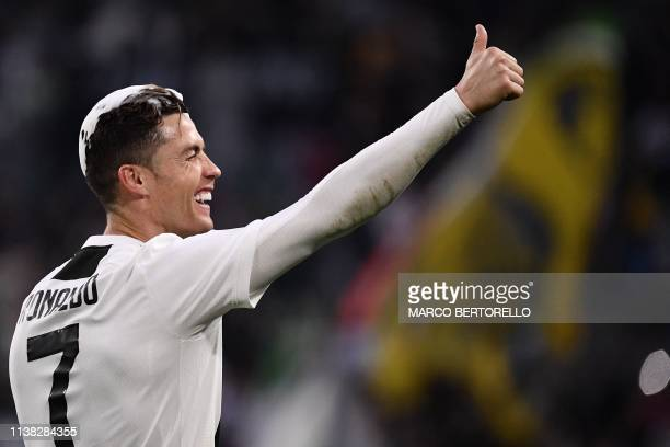 Juventus' Portuguese forward Cristiano Ronaldo acknowledges fans and celebrates after Juventus secured its 8th consecutive Italian 2018/19 Scudetto...