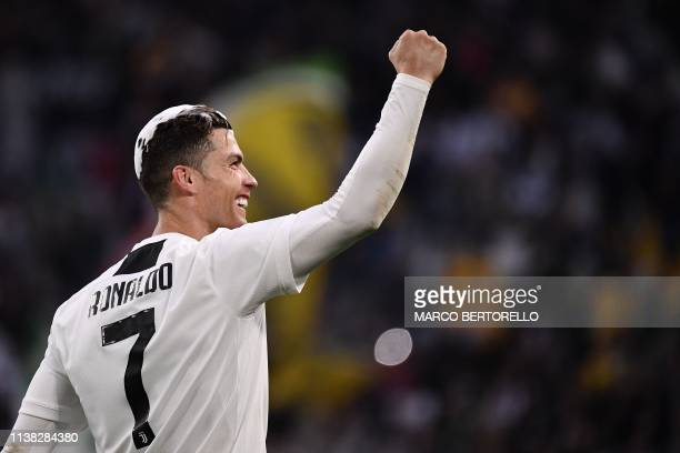 TOPSHOT Juventus' Portuguese forward Cristiano Ronaldo acknowledges fans and celebrates after Juventus secured its 8th consecutive Italian 2018/19...
