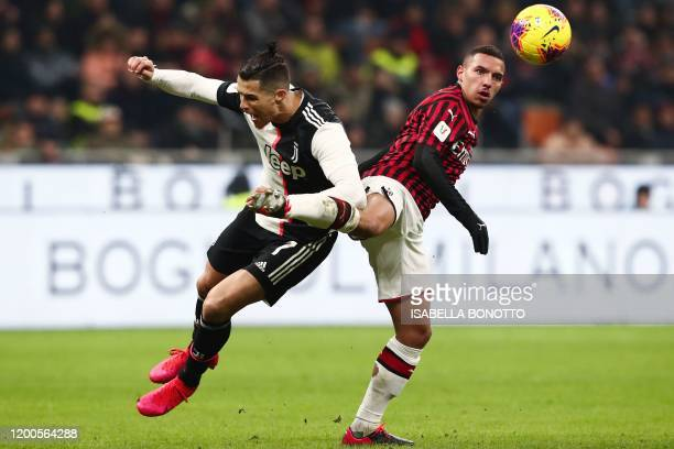 Juventus' Portuguese forward Cristiano Ronaldo and AC Milan's Algerian defender Ismael Bennacer collide during the Italian Cup semifinal first leg...