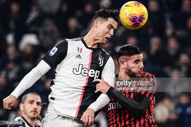 TOPSHOT Juventus' Portuguese forward Cristiano Ronaldo and AC Milan's French defender Theo Hernandez go for a header during the Italian Serie A...
