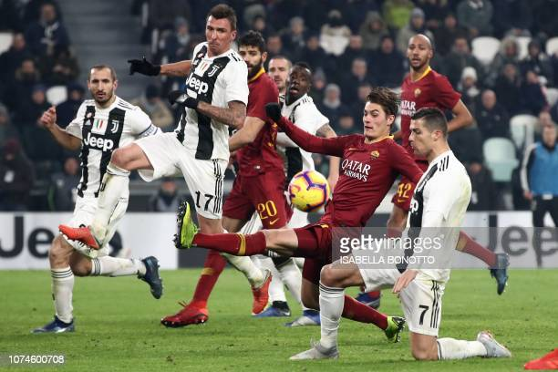 Juventus' Portuguese forward Cristiano Ronaldo and AS Roma Czech forward Patrik Schick go for the ball during the Italian Serie A Football match...
