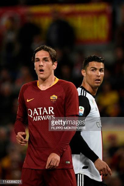 Juventus' Portuguese forward Cristiano Ronaldo and AS Roma Italian midfielder Nicolo Zaniolo look on during the Italian Serie A football match...