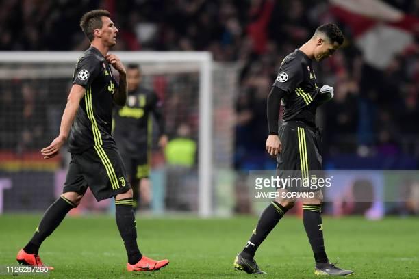 Juventus' Portuguese forward Cristiano Ronaldo and Juventus' Croatian forward Mario Mandzukic leave the pitch at the end of the UEFA Champions League...