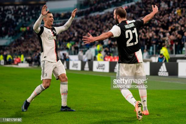 Juventus' Portuguese forward Cristiano Ronaldo and Juventus' Argentinian forward Gonzalo Higuain celebrate after scoring during the Italian Serie A...