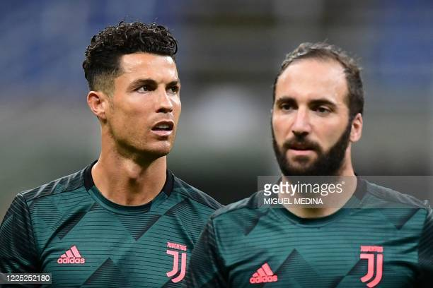 Juventus' Portuguese forward Cristiano Ronaldo and Juventus' Argentinian forward Gonzalo Higuain warm up prior to the Italian Serie A football match...