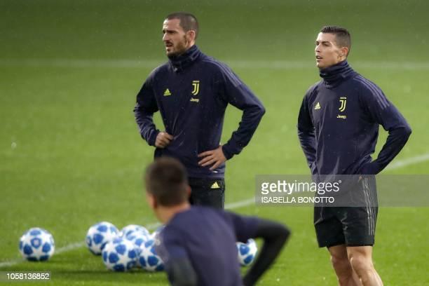Juventus' Portuguese forward Cristiano Ronaldo and Juventus' Italian defender Leonardo Bonucci attend a training session at the Contassina training...