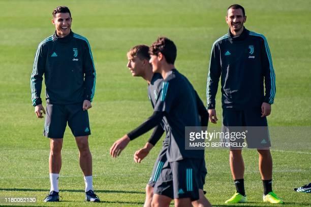 Juventus' Portuguese forward Cristiano Ronaldo and Juventus' Italian defender Leonardo Bonucci react during a training session on November 5, 2019 at...