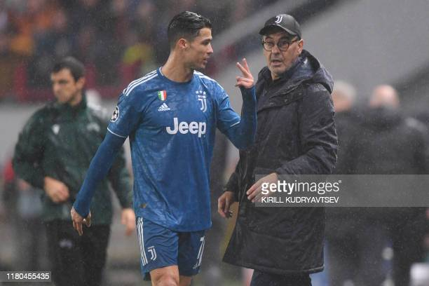 Juventus' Portuguese forward Cristiano Ronaldo and Juventus' Italian coach Maurizio Sarri during the UEFA Champions League group D football match...