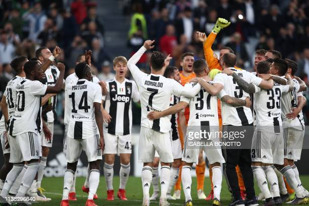 Juventus' Portuguese forward Cristiano Ronaldo and Juventus players celebrate after Juventus secured its 8th consecutive Italian 2018/19 Scudetto...