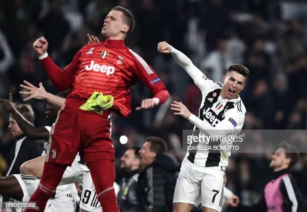 Juventus' Portuguese forward Cristiano Ronaldo and Juventus' Polish goalkeeper Wojciech Szczesny celebrate at the end of the UEFA Champions League...