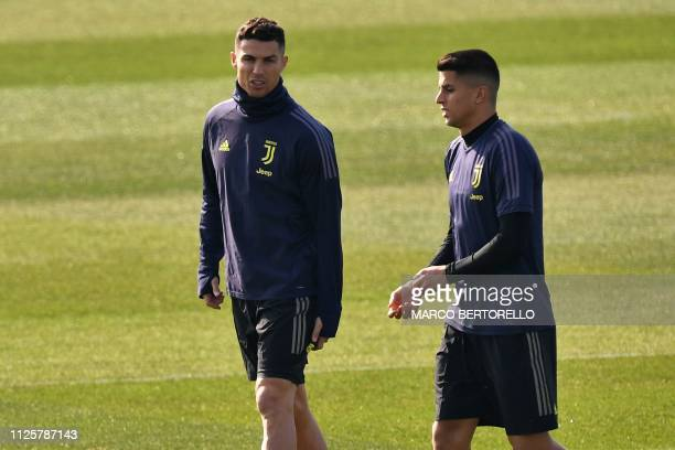Juventus' Portuguese forward Cristiano Ronaldo and Juventus' Portuguese defender Joao Cancelo talk during a training session at the Continassa...