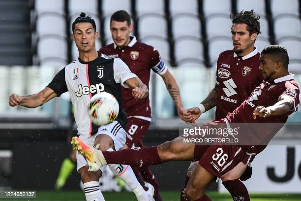 Juventus' Portuguese forward Cristiano Ronaldo and Torino's Brazilian defender Bremer go for the ball during the Italian Serie A football match...