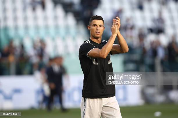 Juventus' Portuguese forward Cristiano Ronaldo applauds prior to the Italian Serie A football match Juventus vs Napoli on September 29 2018 at the...