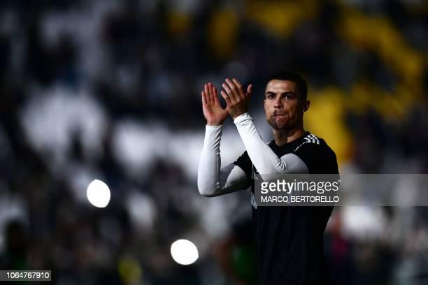 TOPSHOT Juventus' Portuguese forward Cristiano Ronaldo applauds prior to the Italian Serie A football match Juventus vs Spal 2013 on November 24 2018...