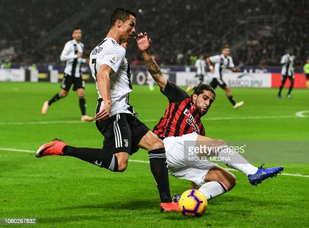 Juventus' Portuguese forward Cristiano Ronaldo attempts to centre despite AC Milan's Swiss defender Ricardo Rodriguez during the Italian Serie A...