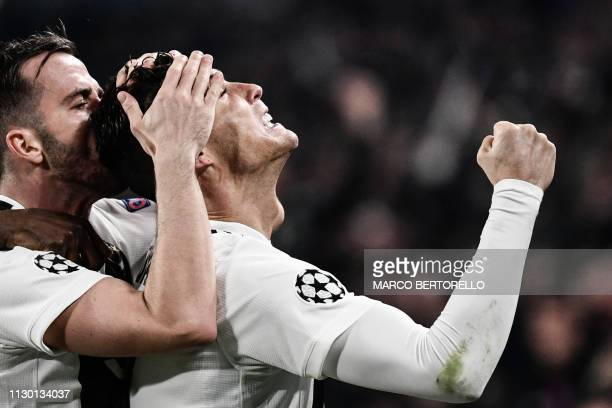 Juventus' Portuguese forward Cristiano Ronaldo celebrates after scoring 20 during the UEFA Champions League round of 16 secondleg football match...