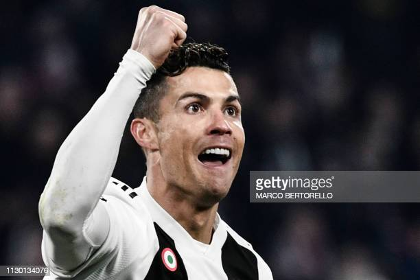 Juventus' Portuguese forward Cristiano Ronaldo celebrates after scoring 20 during the UEFA Champions League round of 16 secondleg football match...