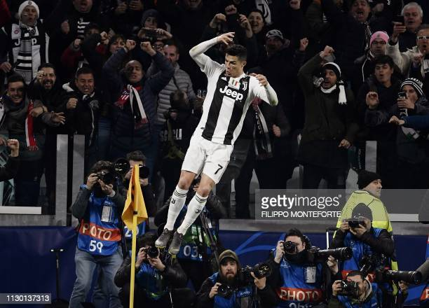 Juventus' Portuguese forward Cristiano Ronaldo celebrates after scoring 30 during the UEFA Champions League round of 16 secondleg football match...