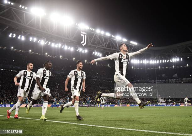 TOPSHOT Juventus' Portuguese forward Cristiano Ronaldo celebrates after scoring 30 during the UEFA Champions League round of 16 secondleg football...